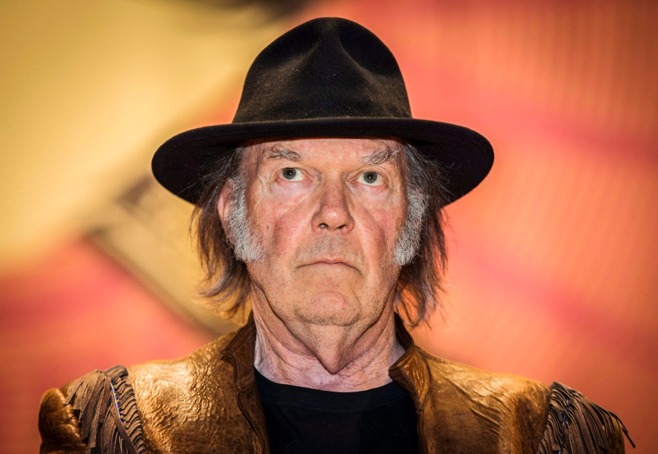 Neil Young speaks during a press conference for the 'Honour the Treaties' tour, a series benefit concerts being held to raise money for legal fight against the expansion of the Athabasca oilsands in northern Alberta and other similar projects, in Toronto, Sunday, Jan. 12, 2014. (Mark Blinch / THE CANADIAN PRESS)