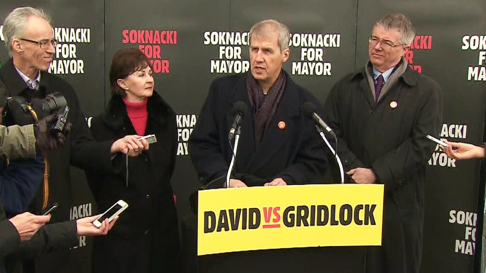 Toronto mayoral candidate David Soknacki, centre right, speaks during a press conference outside Lawrence Station in Toronto on Tuesday, Jan. 14, 2014.