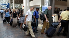 Travelers wait in line to board Amtrak's Northeast Regional train to Boston at Union Station in Washington, Friday, Aug. 26, 2011. (AP / Cliff Owen)
