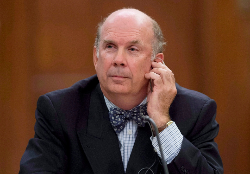 Justice Marc Nadon listens to opening remarks as he appears before a parliamentary committee following his nomination to the Supreme Court of Canada on Parliament Hill in Ottawa, on Wednesday, Oct. 2, 2013. (Adrian Wyld / THE CANADIAN PRESS)