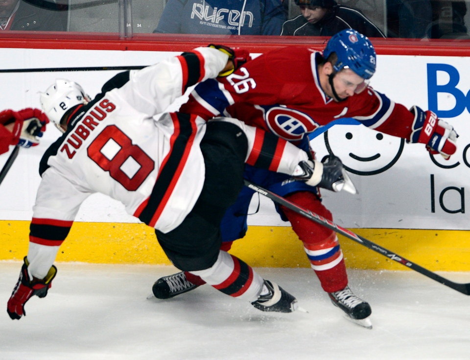 New Jersey Devils right wing Dainius Zubrus (8) runs into Montreal Canadiens defenseman Josh Gorges (26) during third period National Hockey League action Tuesday, January 14, 2014 in Montreal.THE CANADIAN PRESS/Ryan Remiorz