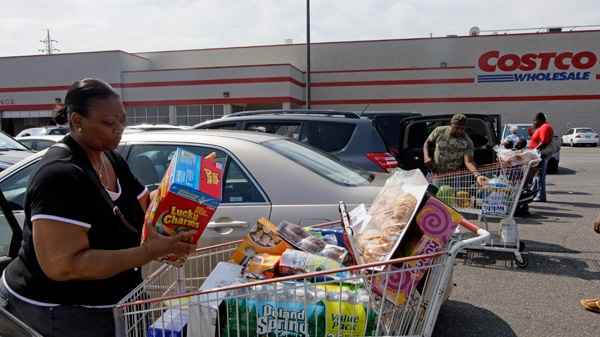 People load their cars with food and water in the Costco parking lot in Lawrence, N.Y., Friday, Aug. 26, 2011. (AP / Mary Altaffer)