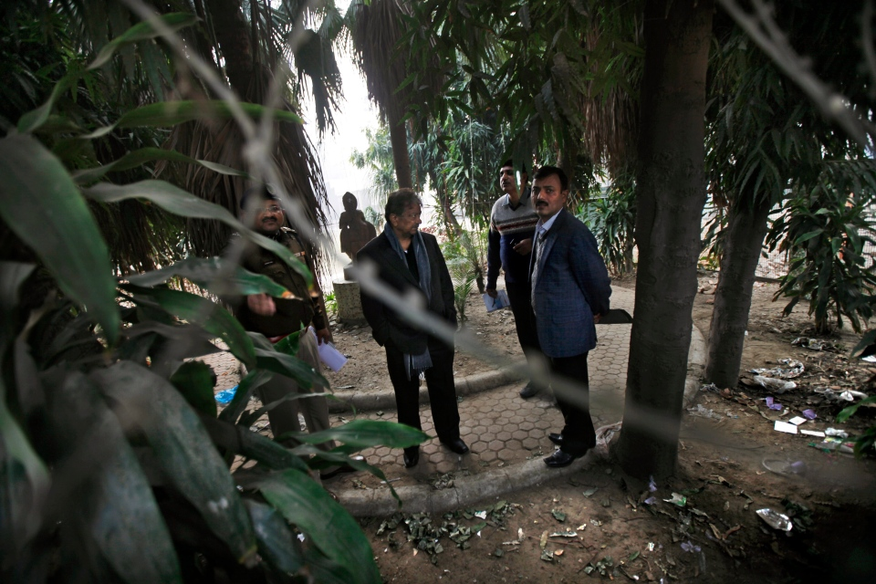 Indian investigators visit a spot which police say is where a Danish tourist was gang-raped in New Delhi, India, Wednesday, Jan. 15, 2014. (AP / Altaf Qadri)