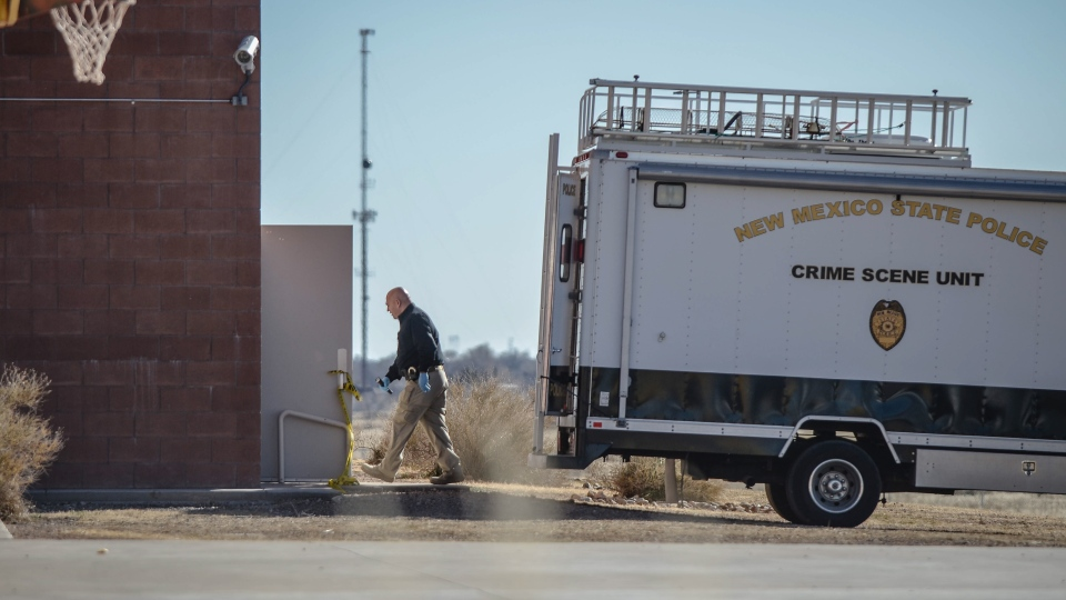 Crime scene investigators enter the gymnasium at Berrendo Middle School in Roswell, N.M., Tuesday, Jan. 14, 2014. (The Albuquerque Journal / Roberto Rosales) JOURNAL