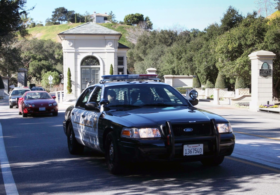 Los Angeles County Sheriff's leave 'The Oaks of Calabasas' property, where the residence of the pop star, Justin Bieber was searched by police in Calabasas, Calif., on Tuesday, Jan 14, 2014. (AP / Nick Ut)