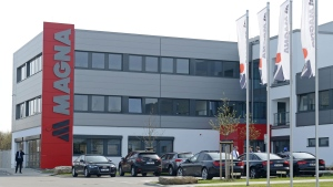 A man walks in front of a new plant of the international automotive supplier Magna in the Magna Exteriors and Interiors (Meerane) GmbH in Meerane, eastern Germany, Wednesday, April 24, 2013. (AP / Jens Meyer)
