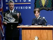 Officers from RCMP 'E' Division display an image of one of the shoes found, during a press conference in Vancouver on Thursday, July 10, 2008.
