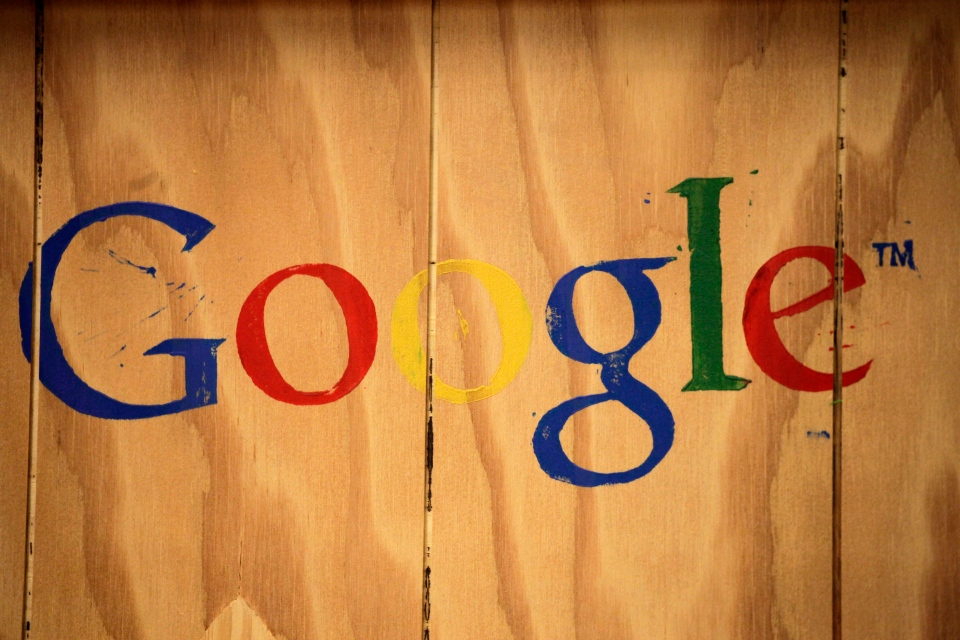 A Google logo is painted on the side of a plywood box at Google offices in New York in this Oct. 17, 2012 file photo. (AP / Mark Lennihan)