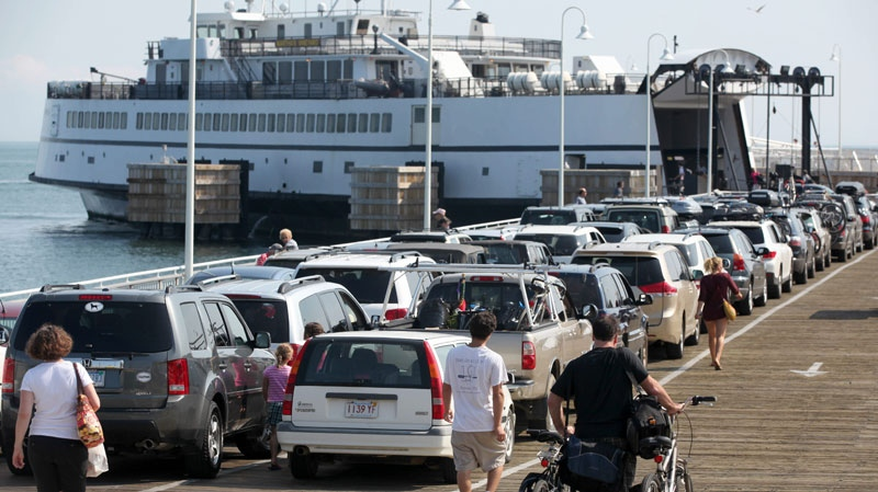 Passengers with cars and bicycles prepare to board a ferry departing the island of Martha's Vineyard, in Oak Bluffs, Mass., Friday, Aug. 26, 2011. The Steamship Authority, which operates ferries between the island and the mainland, has added additional vessels to the schedule in anticipation of the arrival of Hurricane Irene. (AP / Steven Senne)