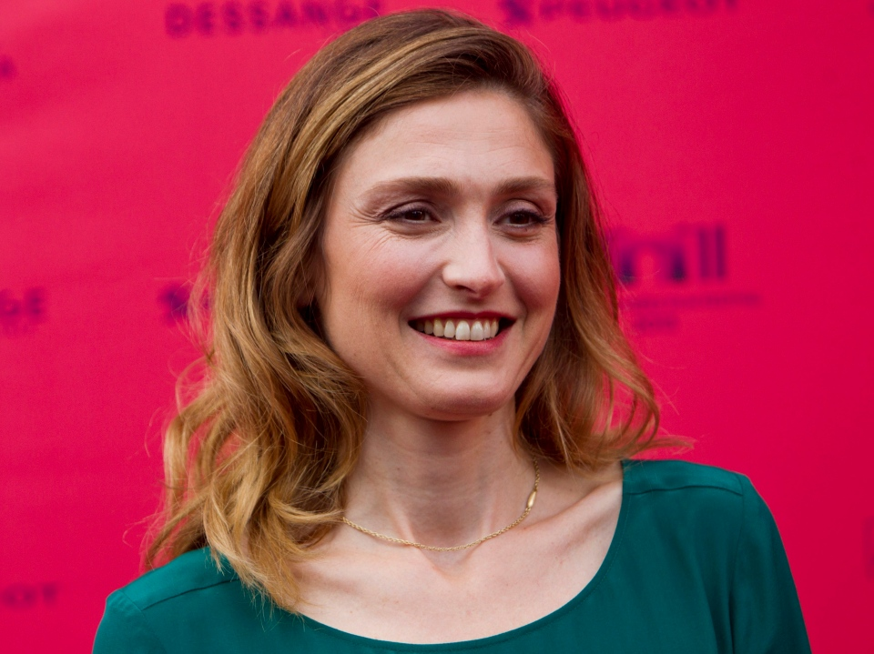 """French actress and Member of the jury Julie Gayet arrives at the premiere of the feature film """"Struck By Lightning"""" during a opening ceremonies of the Champs-Elysees Film festival, at the """"Publicis"""" in Paris, Wednesday, June 12, 2013. (AP / Jacques Brinon)"""