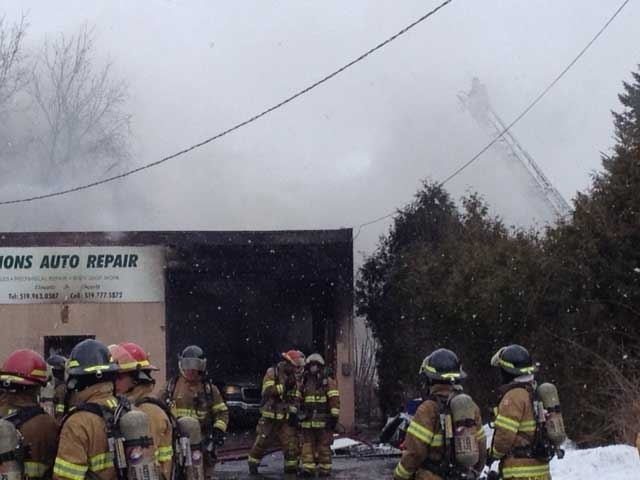 Firefighters battle a blaze at an auto shop in east London, Ont. on Wednesday, Jan. 15, 2014. (Sean Irvine / CTV London)