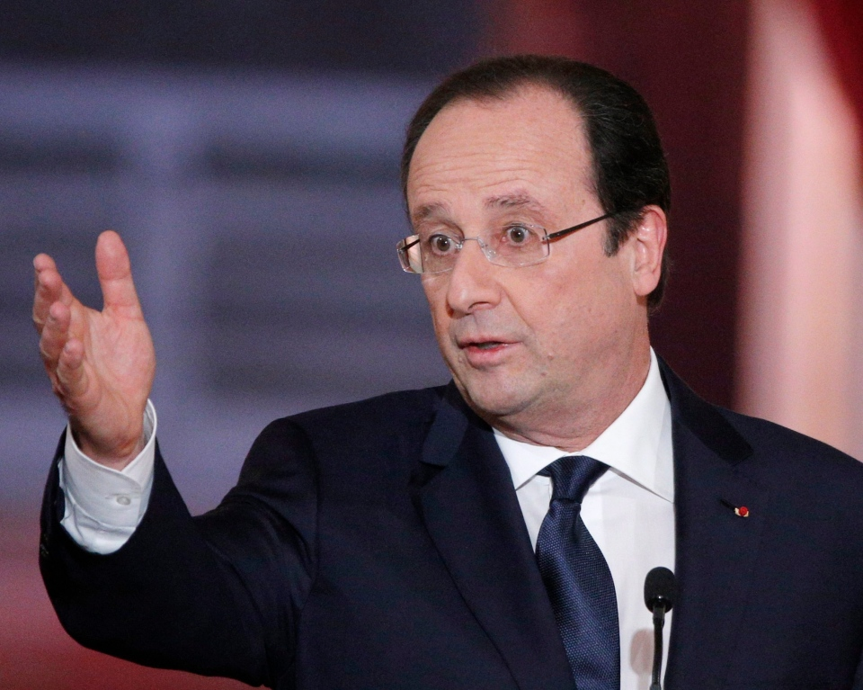 French President Francois Hollande answers a reporter during his annual news conference at the Elysee Palace in Paris, Tuesday, Jan.14, 2014. (AP / Christophe Ena)