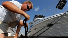 Bill Latta adds another line for his boat 'Changes in Latta-tude' at Anchorage Marina before the arrival of Hurricane Irene, Friday, Aug. 26, 2011, in Baltimore. (AP / Alex Brandon)