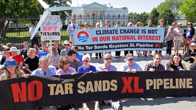 Environmental activists gather outside the White House in Washington as they continue a civil disobedience campaign against a proposed oil pipeline from Canada to the U.S. Gulf Coast, Monday, Aug. 22, 2011. (AP / J. Scott Applewhite)