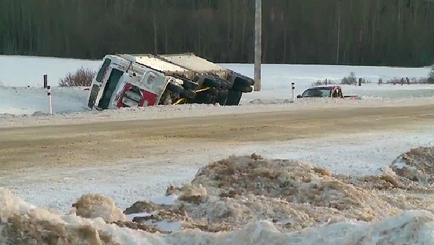 Person killed after passing semi-truck blown into ditch | CTV News