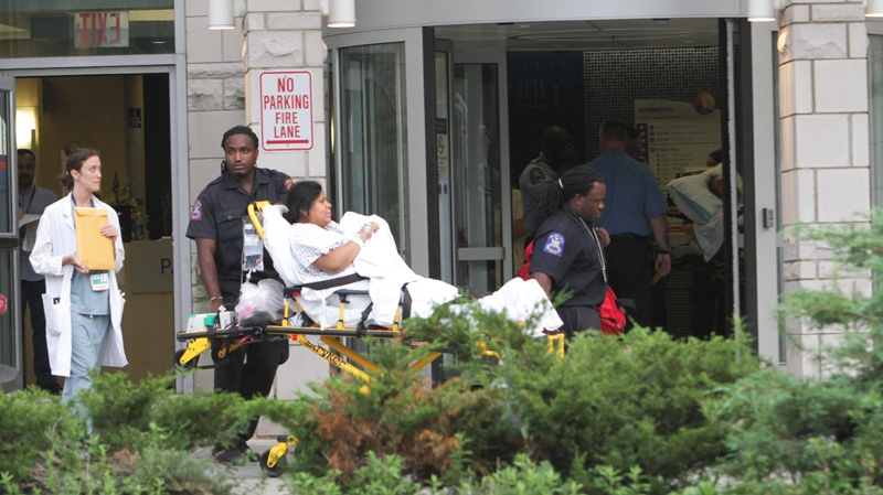 A patient is evacuated from Coney Island Hospital in preparation for Hurricane Irene in Brooklyn, N.Y., Friday, Aug. 26, 2011. (AP / Mary Altaffer)