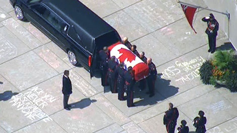 The casket of Jack Layton is transported to Roy Thompson Hall for his state funeral in Toronto, Saturday, Aug. 27, 2011.