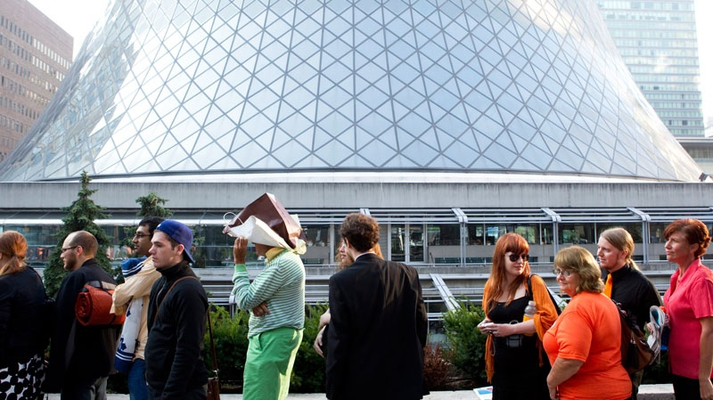 Supporters queue for a ticket to attend the funeral of the late NDP leader Jack Layton, at Roy Thompson Hall, in Toronto on Saturday, August 27, 2011. Chris Young / THE CANADIAN PRESS