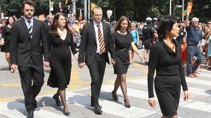 Olivia Chow, stepson Mike Layton and stepdaughter Sarah Campbell, and other family members follow the hearse during a funeral procession for the late NDP leader Jack Layton during in Toronto on Saturday, Aug. 27, 2011. (Ryan Remiorz / THE CANADIAN PRESS)