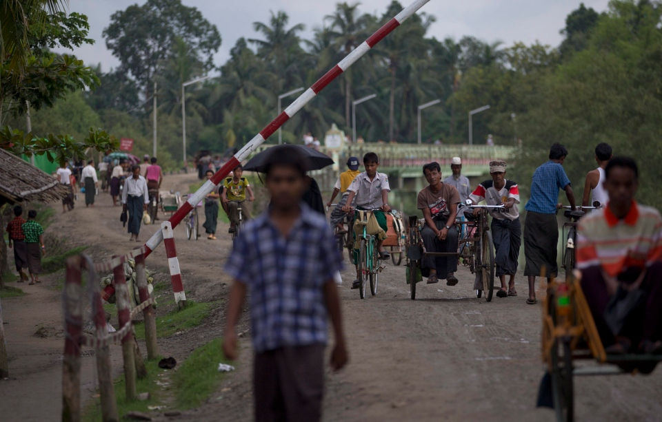 Muslims travel past a road barrier next to a security checkpoint in Maungdaw, northern Rakhine state, Myanmar on Sept. 14, 2013. (AP / Gemunu Amarasinghe)