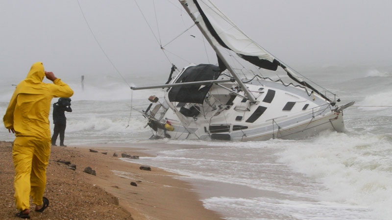 A stranded sailboat founders in the surf along the Willoughby Spit area of Norfolk, Va. as Hurricane Irene hits Norfolk, Va., Saturday, Aug. 27, 2011.  (AP / Steve Helber)