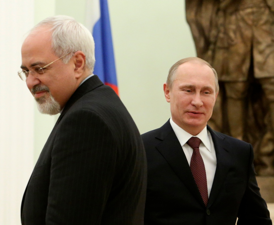 Russian President Vladimir Putin, right, passes by Iranian Foreign Minister Mohammad Javad Zarif during their meeting in the Kremlin in Moscow, Russia, Thursday, Jan. 16, 2014. (AP / Sergei Karpukhin)