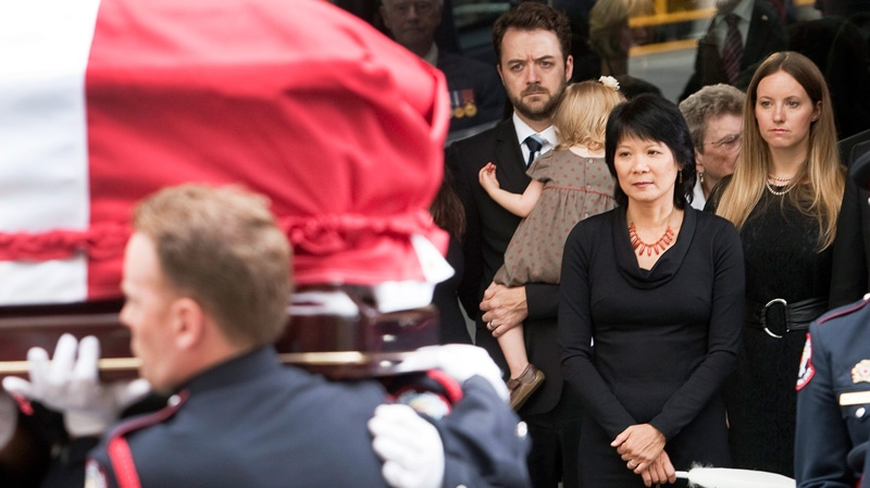 Olivia Chow and family members look on as the coffin of NDP leader Jack Layton leaves Roy Thomson Hall after his state funeral, Saturday, Aug. 27, 2011 in Toronto.(Ryan Remiorz / THE CANADIAN PRESS)