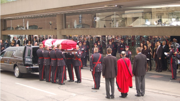 Jack Layton's casket is carried into a hearse following his state funeral at Roy Thomson Hall in Toronto on Aug. 27, 2011. (Michael Stittle / CTVNews.ca)