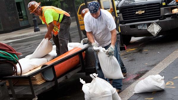 Workers unload sandbags in preparation for Hurricane Irene in Manhattan's Battery Park City in New York, Saturday, Aug. 27, 2011. (AP / John Minchillo)