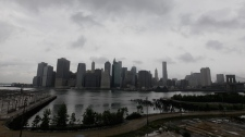 Storm clouds loom over lower Manhattan in New York, Saturday, Aug. 27, 2011. (AP / Mary Altaffer)