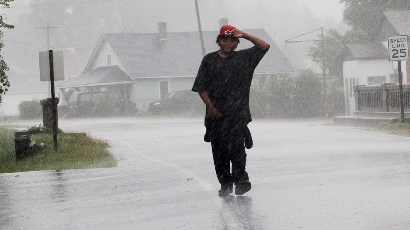 Antoine White walks in the effects of Hurricane Irene in Elizabeth City, N.C., Saturday, Aug. 27, 2011 as the storm moves up the North Carolina coast. (AP / Jim R. Bounds)