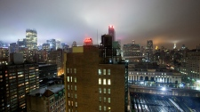 The New York City skyline is seen under clouds as Hurricane Irene approaches, Saturday, Aug. 27, 2011. (AP / Karly Domb Sadof)