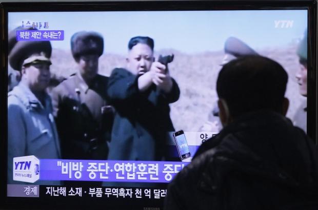 North Korean Leader Kim Jong Un on a TV screen