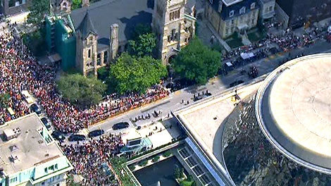 Thousands gather as the casket of Jack Layton arrives at Roy Thompson Hall in Toronto, Saturday, Aug. 27, 2011.