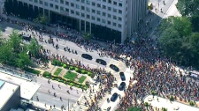 In this aerial view from the CTV News helicopter, large crowds following the procession to Roy Thompson Hall in Toronto, Saturday, Aug. 27, 2011.