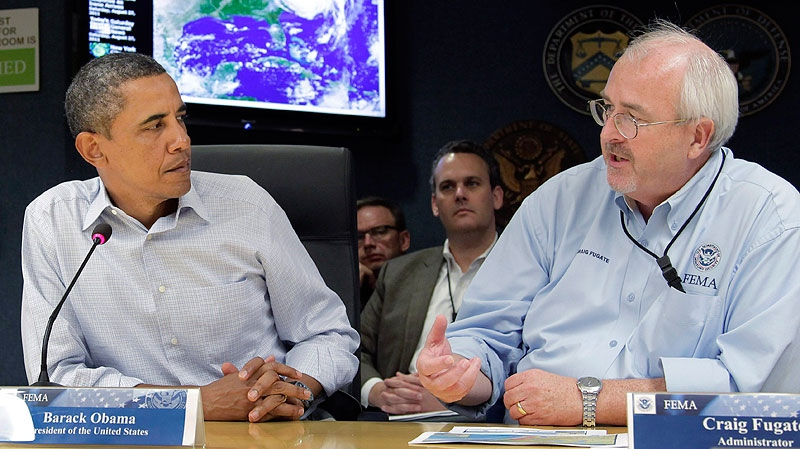 President Barack Obama listens to an update on the status of Hurricane Irene by FEMA director Craig Fugate, right, at Federal Emergency Management Agency (FEMA) headquarters in Washington Saturday, Aug. 27, 2011. (AP / J. Scott Applewhite)