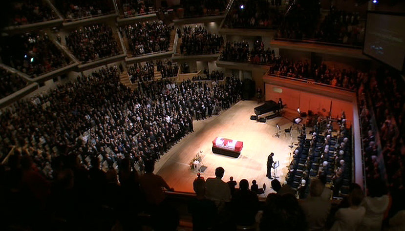 The casket of Jack Layton is displayed during the state funeral at Roy Thompson Hall in Toronto, Saturday, Aug. 27, 2011.