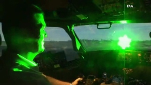 A pilot in a simulator gets trained to land a plane while the laser is pointed into the cockpit. (File)