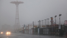 The Coney Island boardwalk in New York is obscured by sand and rain as Hurricane Irene reached the area Sunday, Aug. 28 2011. (AP / Craig Ruttle)