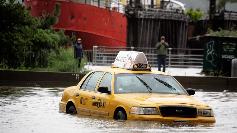 A New York City taxi is stranded in deep water on Manhattan's West Side as Tropical Storm Irene passes through the city, Sunday, Aug. 28, 2011 in New York. (AP / Peter Morgan)