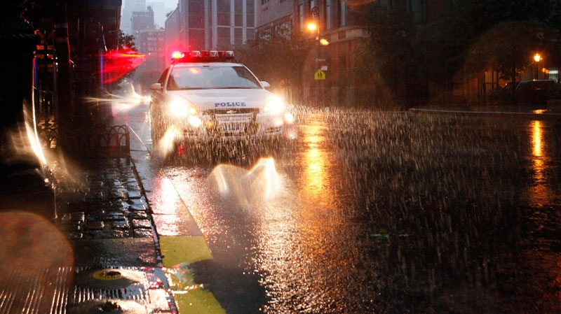 Heavy rain falls as a police car drives in Battery Park City in New York as Hurricane Irene approaches, Sunday, Aug. 28, 2011. (AP / Jason DeCrow)