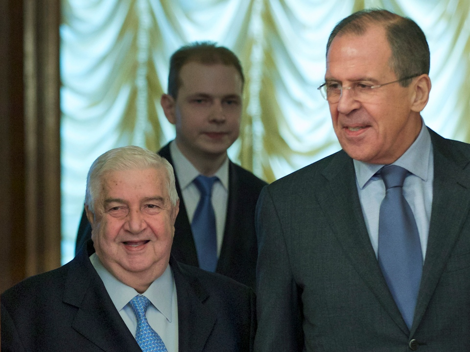 Russian Foreign Minister Sergey Lavrov, right, and his Syrian counterpart Walid al-Moallem arrive for talks in Moscow, Russia, on Friday, Jan. 17, 2014. (AP Photo/Ivan Sekretarev)