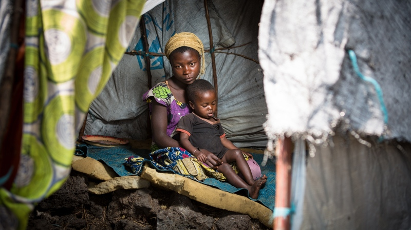 Fifteen-year-old Neema and her two-month-old sister live in a camp for Internally Displaced People (IDP) in Goma, Democratic Republic of Congo. (Paul Bettings/World Vision Canada)