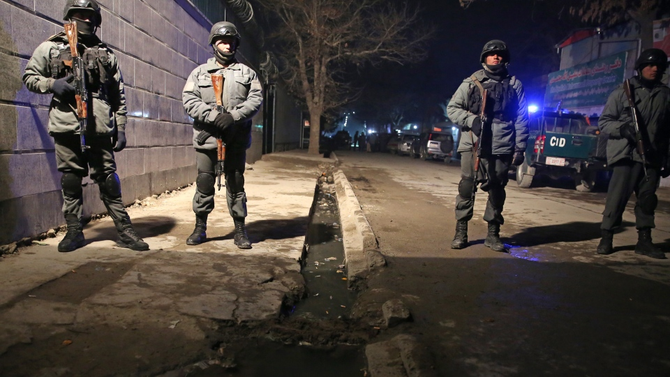 Afghan police forces stand guard at the site of a suicide attack in Kabul, Afghanistan, Friday, Jan. 17, 2014. (AP / Massoud Hossaini)