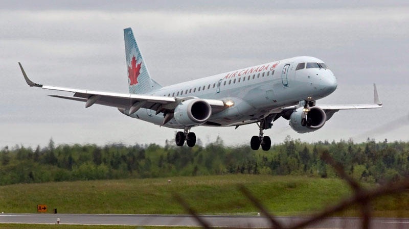 An Air Canada jet lands the airport in Halifax on June 10, 2011. (Andrew Vaughan / THE CANADIAN PRESS)