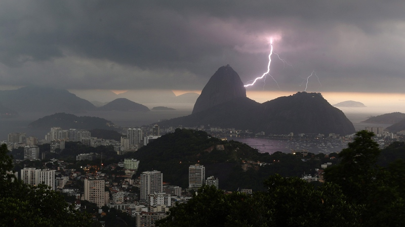 Lightning lights up the the sky over Sugar Loaf mountain in Rio de Janeiro, Brazil, Thursday, Jan.16, 2014. An alert was called by Rio authorities due to heavy rains and the possibilty of floods in the city. (AP / Leo Correa)
