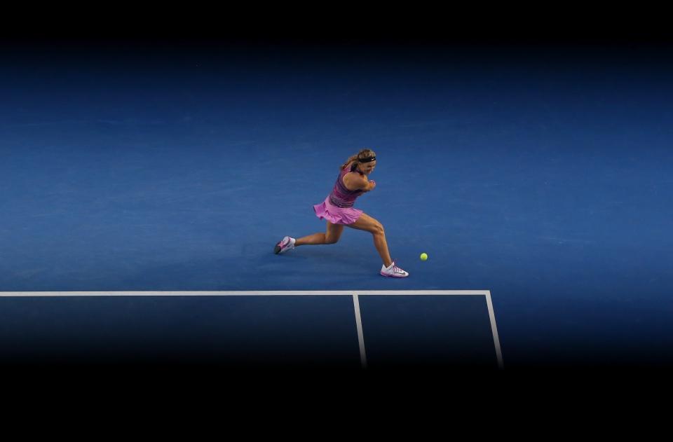 Victoria Azarenka, of Belarus, hits a backhand return to Yvonne Meusburger, of Austria, during their third match at the Australian Open tennis championship in Melbourne, Australia on Jan. 18, 2014. (AP Photo/Eugene Hoshiko)