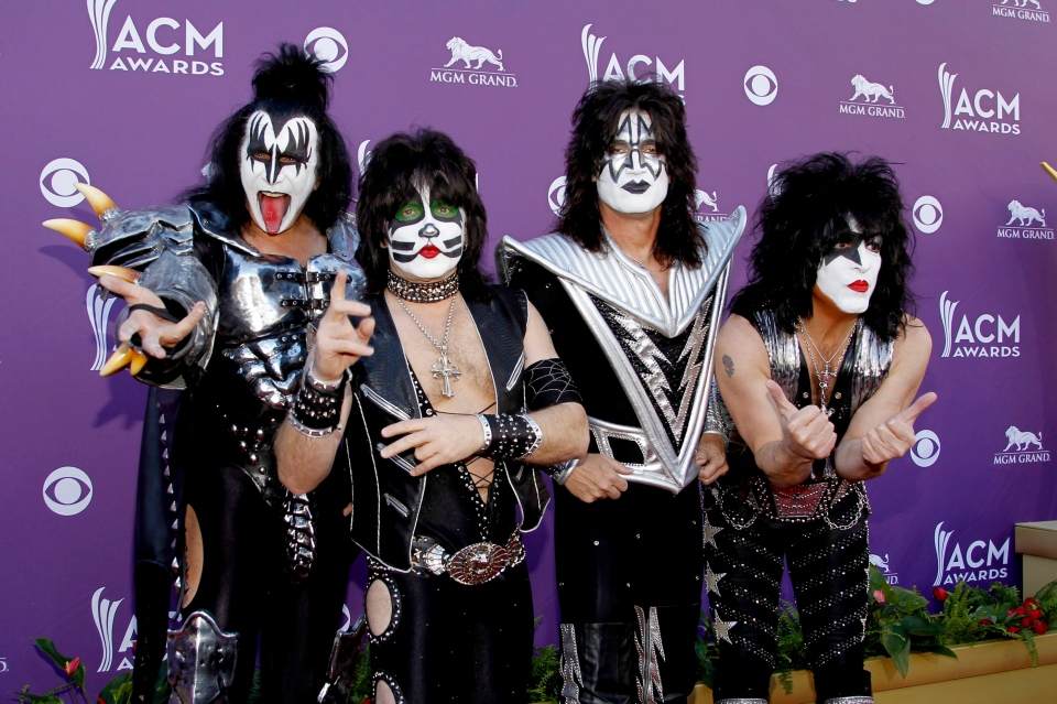 Gene Simmons, Eric Singer, Tommy Thayer and Paul Stanley, of the musical group KISS, arrive at the 47th Annual Academy of Country Music Awards in Las Vegas on Sunday, April 1, 2012. (AP / Isaac Brekken)