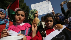 Palestinian children attend a rally in solidarity with Palestinian refugees in Yarmouk refugee camp in the suburbs of the Syrian capital of Damascus, in Gaza City, Thursday, Jan. 16, 2014. (AP / Hatem Moussa)