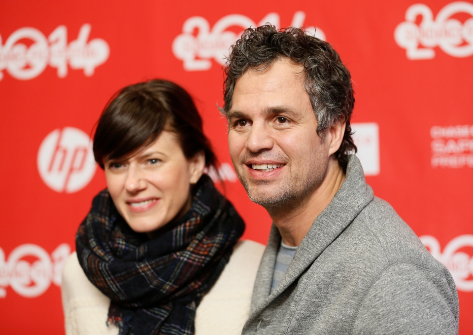 "Cast member Mark Ruffalo, right, poses with his wife Sunrise Coigney, left, at the premiere of the film ""Infinitely Polar Bear"" during the 2014 Sundance Film Festival, on Saturday, Jan. 18, 2014 in Park City, Utah. (Photo by Danny Moloshok/Invision/AP)"